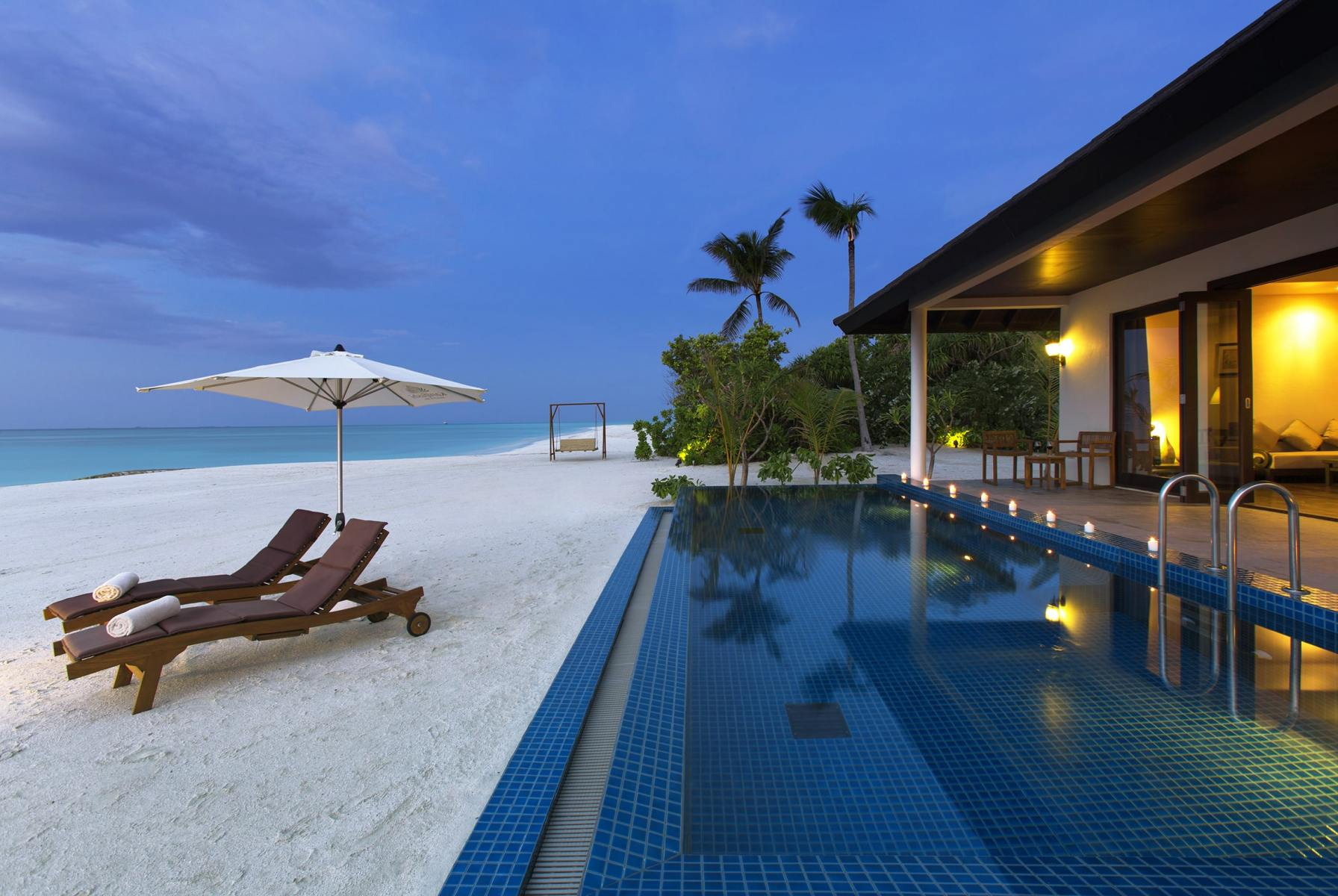 SUNSET-POOL-VILLA-AT-DUSK-WITH-SWING-AND-SANDBANK-IN-BACKGROUND-min